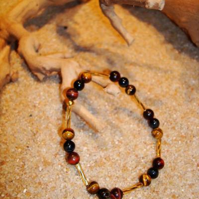 BRACELET EN OEIL DE TIGRE, TAUREAU,FAUCON et perles de roches dorées TAILLE L (19 à 22 cm)